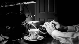 Film noir writer using a typewriter.