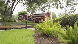 Firetruck parked in the parking lot of an office building 4k