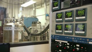 Focus from nitrogen tank to digital displays of control panel.