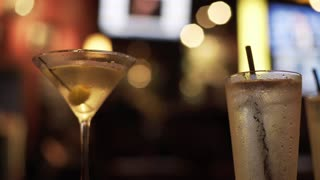 focus on two drinks in a colorfull bar 4k