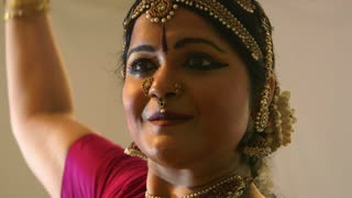following the movements of an Indian dancer