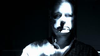 ghostly man looking at camera