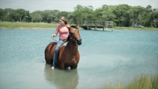 girl and her horse in the pond