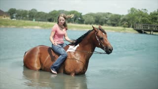 girl and horse in the pond closeup