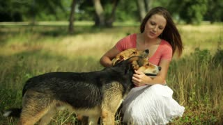 girl with her dogs smiles at camera