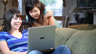 girls studying on laptop