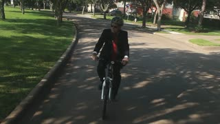 green concept businessman riding his bike to work.