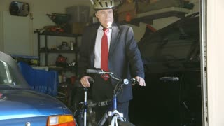 green concept businessman taking bike out of garage.