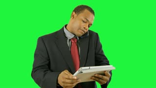 green screen businessman with tablet pc and cell.