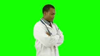 green screen doctor turns toward camera.