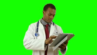 green screen doctor with tablet pc smiles at camera.