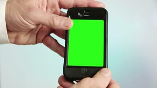green screen holding a smart phone