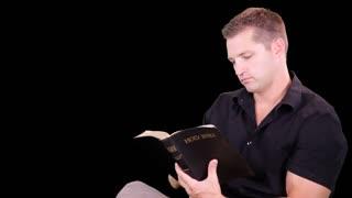 green screen man reading bible close