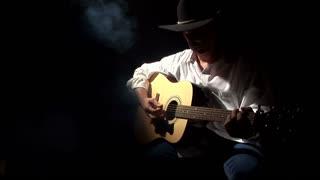 guitar playing cowboy