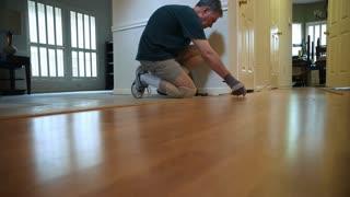handyman removing floor molding