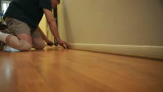 handyman removing molding from floor