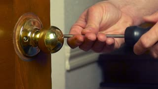 handyman removing the door knob 1080HD