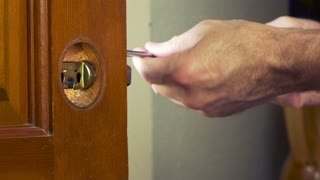 handyman removing the door latch 1080hd