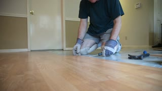 handyman removing wood flooring
