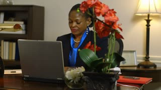 hard working woman corporate CEO busy in her office