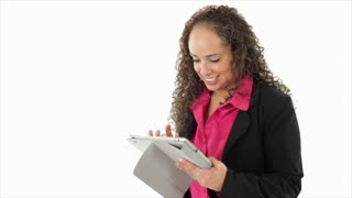 Hispanic businesswoman using a tablet