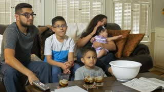 hispanic family watching tv 4k