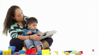 Hispanic mom and son using a tablet