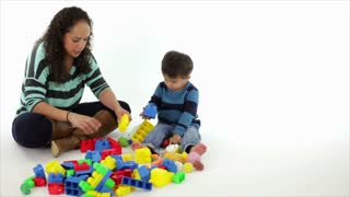Hispanic mom playing with her son