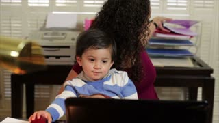 Hispanic mom working with some files.