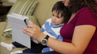 Hispanic mother and son using tablet.