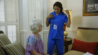 home healthcare nurse checking her patients breathing