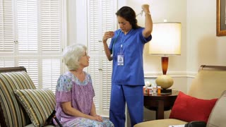 home healthcare nurse checks the patients breathing