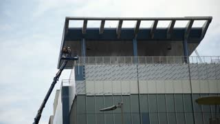 Houston, TX - October 01, construction workers working on the side of a new office building 4k