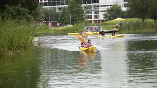 Houston, TX - October 01, kayak boats in Discovery green urban park 4k