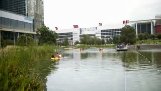 Houston, TX - October 01, wide shot of kayak boats in Discovery green urban park 4k