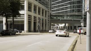 Houston, TX - October 06, typical downtown busy street with traffic 4k
