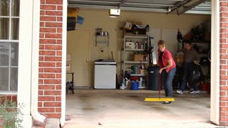 husband and wife cleaning garage