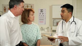 husband and wife talk to doctor