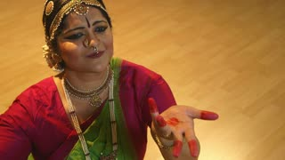 Indian dancer focus on hand movements.