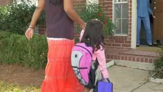 Indian mother drops preschool daughter off with babysitter or grandmother.