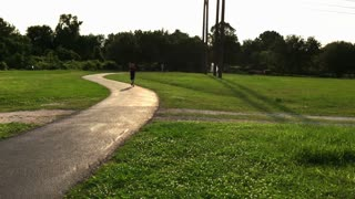 joggers on a path in a public park 4k
