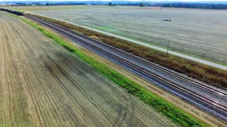Kansas City Ks November 06 Aerial Pan View Of A Frieght Train Traveling Through Rural Farm Land