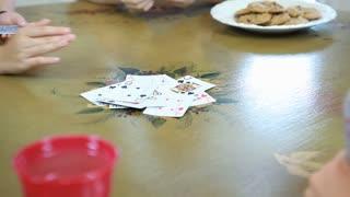 kids playing cards close