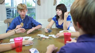 kids playing cards over shoulder