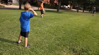 kids playing catch slow motion