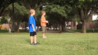 kids playing with their dad catch ball
