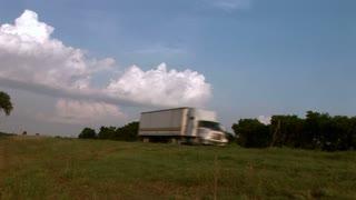 Large Cargo Trucks Travel Down Highway