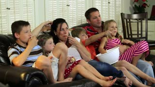 Large family watching television.