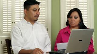 Latino couple going over bills
