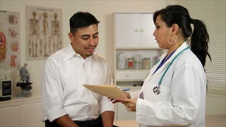latino woman doctor shakes hands with her paitent